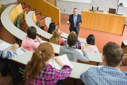 Lecturer and students in lecture hall