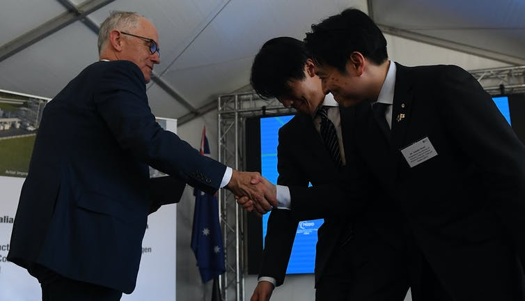 Then prime minister Malcolm Turnbull shakes hands with a Japanese dignitary at Loy Yang A power station in Victoria.