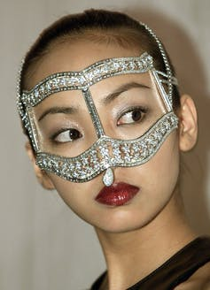 Japanese woman wears diamond eye mask.