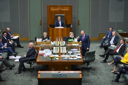 Labor leader Anthony Albanese speaking in parliament. Scott Morrison has his back turned while frontbenchers watch on.