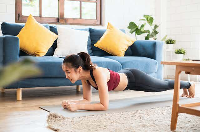 Woman planking at home