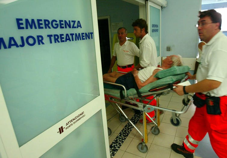 An elderly man is wheeled into the emergency room of an Italian hospital.