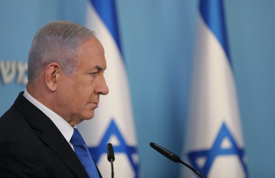 Benjamin Netanyhu with Israeli flags.