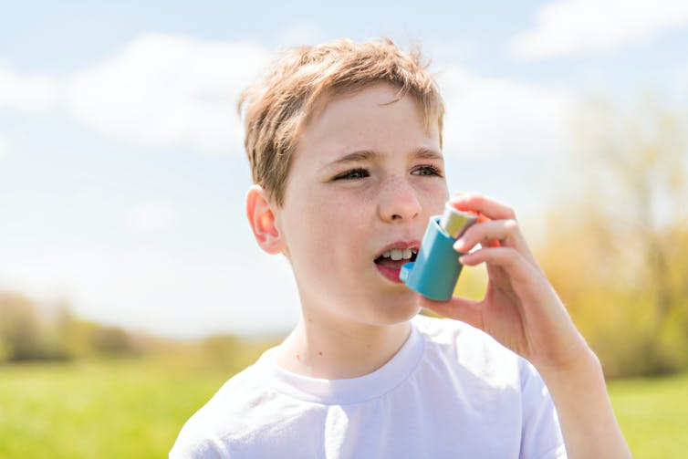 Child using inhaler.