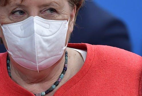 Angela Merkel wearing a mask.