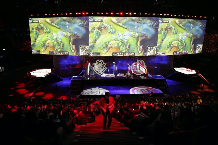 An arena full of people watching an international videogame tournament