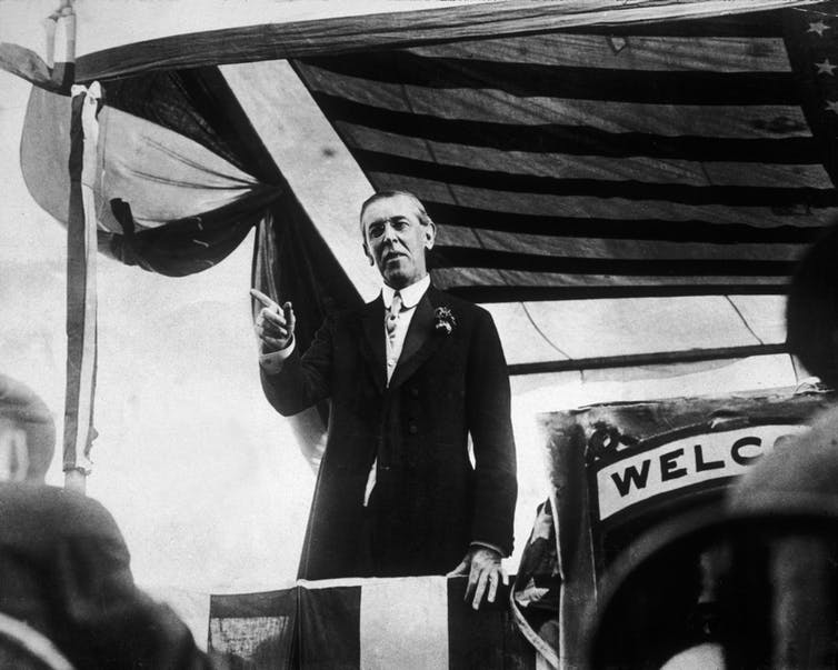 President Woodrow Wilson, speaking from a platform.