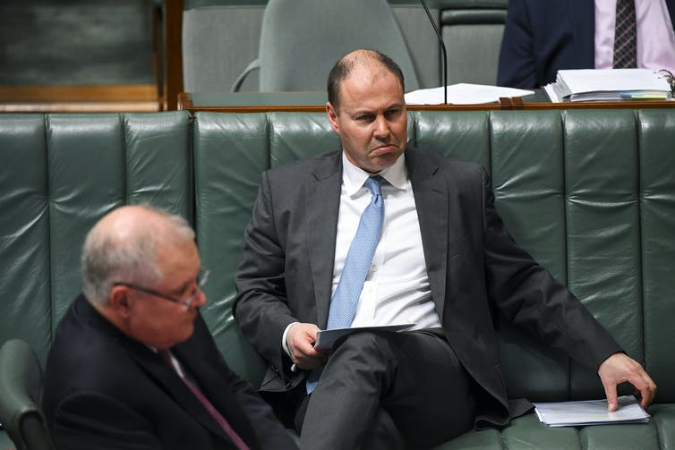 Treasurer Josh Frydenberg pulling a sad face on the frontbencher, with Prime Minister Scott Morrison in foreground.