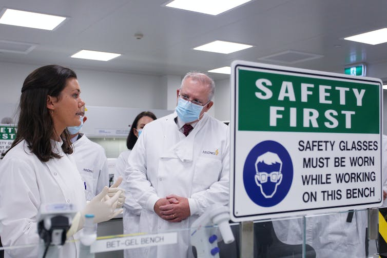 Scott Morrison talks with a scientist during a visit to AstraZeneca laboratories in Sydney.