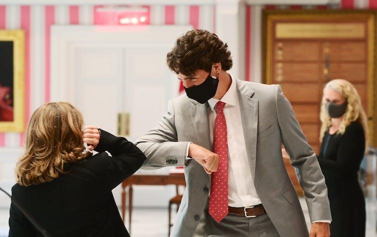 Justin Trudeau elbow bumping Chrystia Freeland