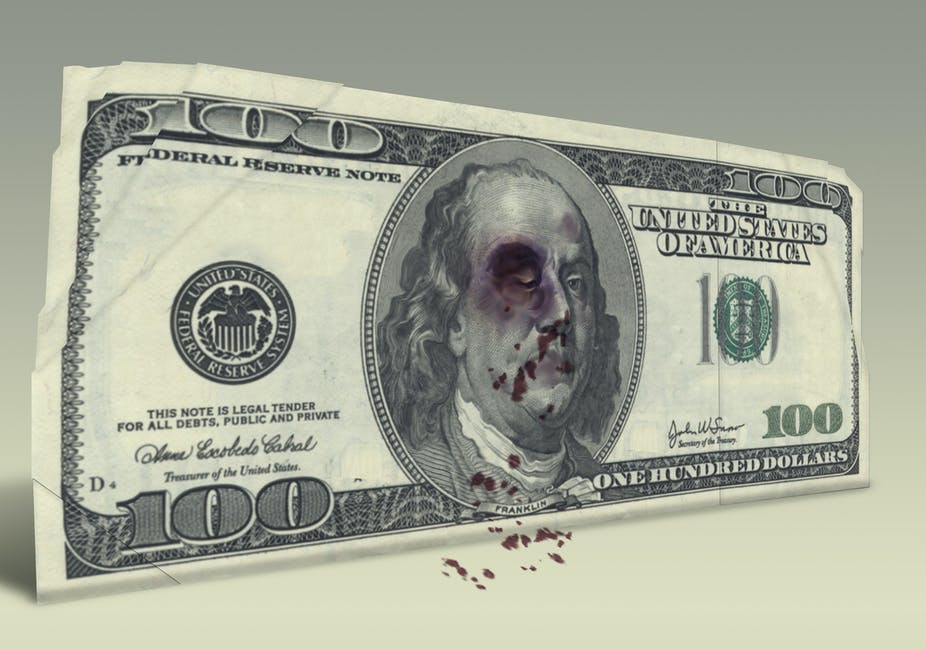 100 dollar bill with Benjamin Franklin with black eye