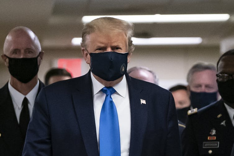 US President Donald Trump wears a mask as he visits Walter Reed National Military Medical Center in July 2020