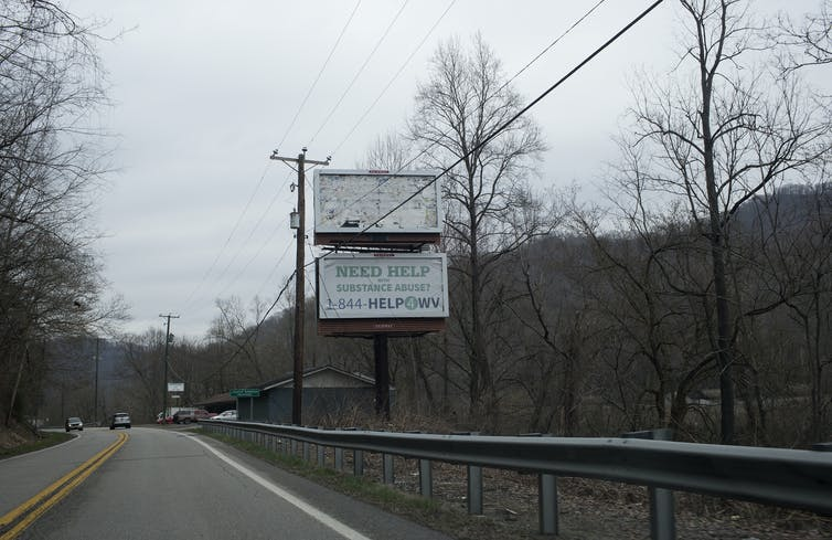 A road sign advertises help for addiction in West Virginia, one of the states hit hardest by the opioid crisis.