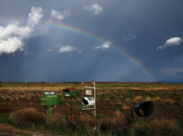 Rainbow over letterboxes in a rural setting