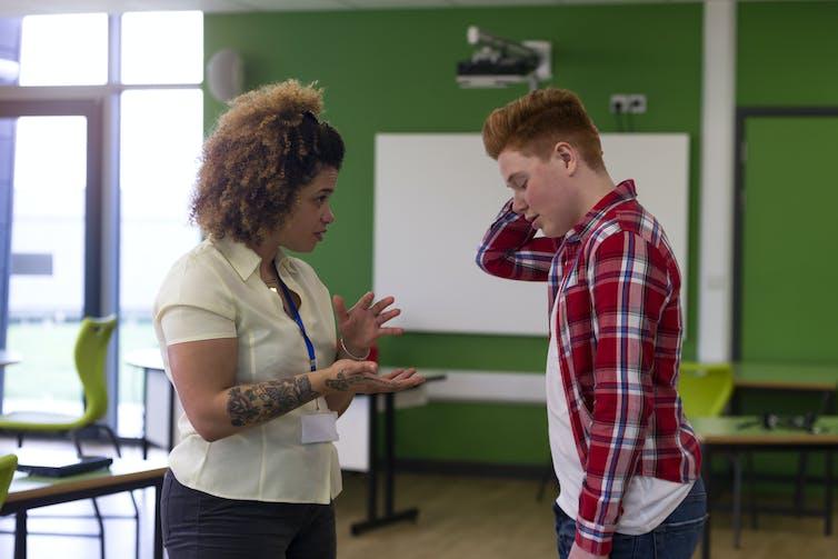 Female teacher tells off teenage boy