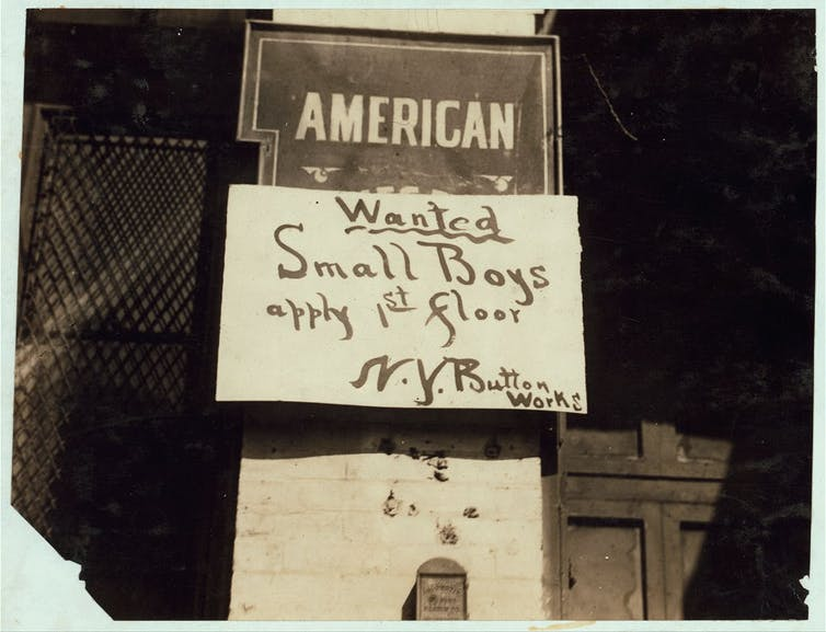 Wanted: Small boys sign in Manhattan in the early 20th century.
