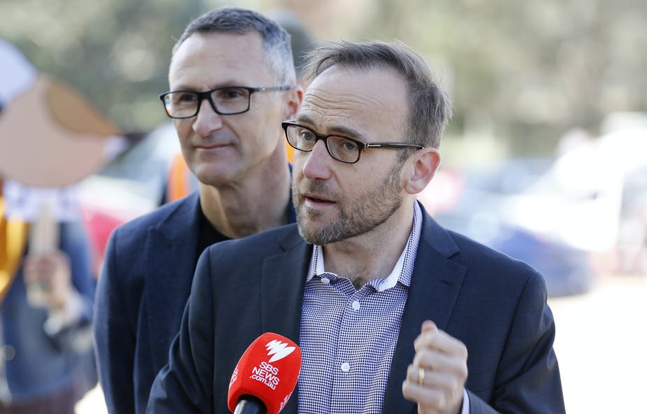 Adam Bandt speaking at a press conference with Richard Di Natale standing behind