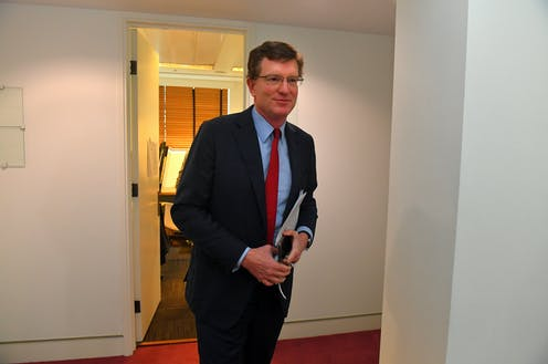 Andrew Gee in the press gallery halls