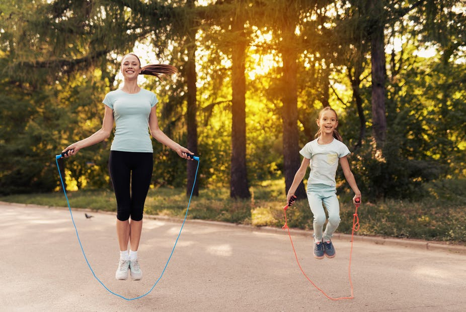 Mom and daughter jumping rope.
