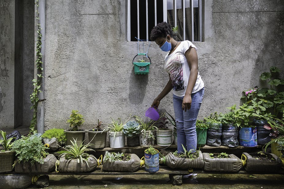 Young woman in Ethiopia watering plants