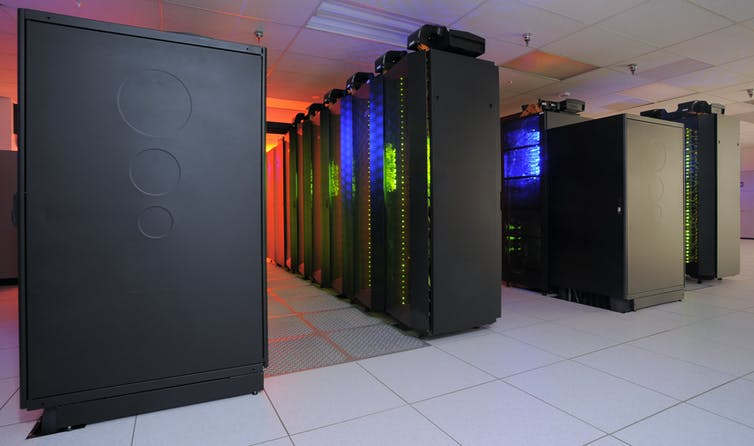 A climate-controlled room containing banks of computer processors