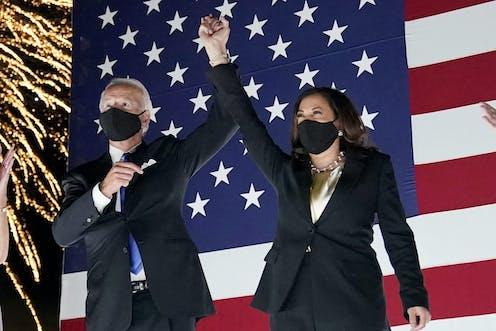 Joe Biden and Kamala Harris, wearing masks, and the DNC