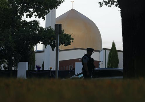 Golden dome of mosque with silhouette of policeman