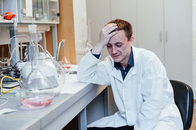 Exhausted young scientist in the lab