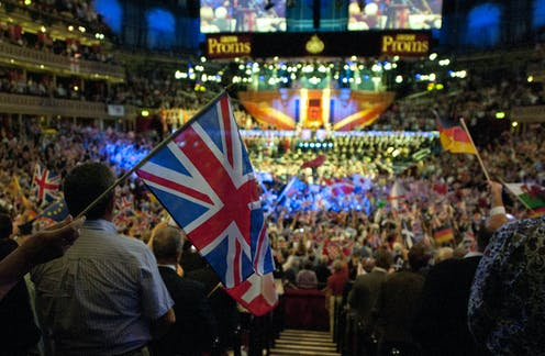 The interior of the ALbert Hall for the Last Night of the Proms in 2014 with thousands of people waving the Union Flag.