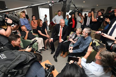 Scott Morrison, surrounded by journalists, at an aged care centre