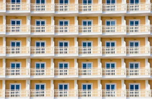 Series of balconies to a yellow hotel building