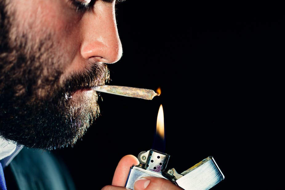 Man lighting up a joint.