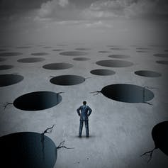 Artists's image of human surrounded by large holes in terrain.