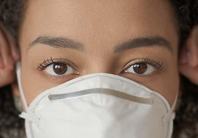 Closeup of woman wearing face mask