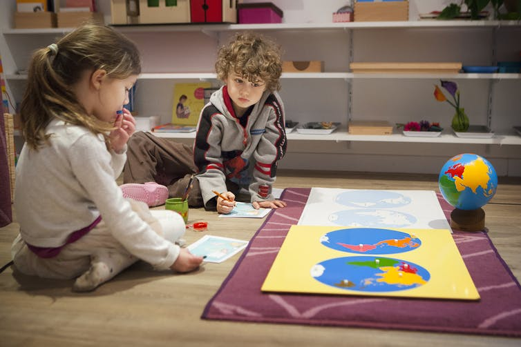 Two kids attending a bilingual Montessori school in Haute-Savoie, France