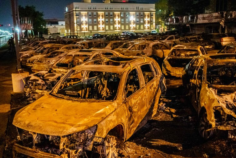 Charred carcasses of used cars burned by protestors