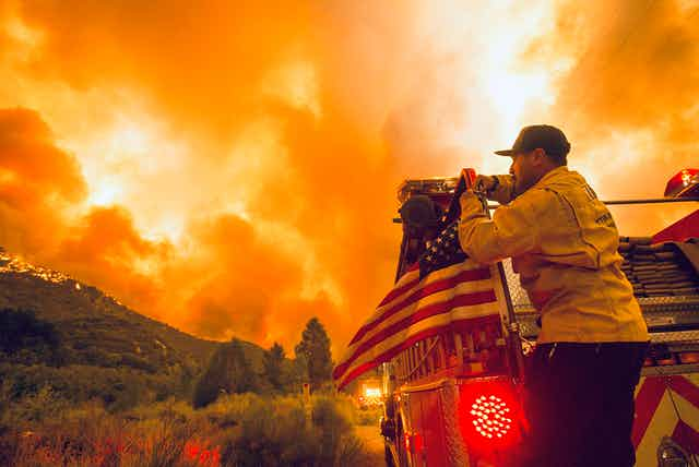 US firefighter watches blaze in California.