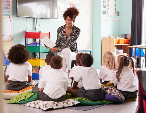 Teacher reads book to children
