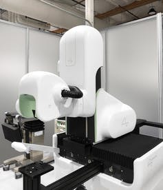 a machine with a helmet-like component in a laboratory