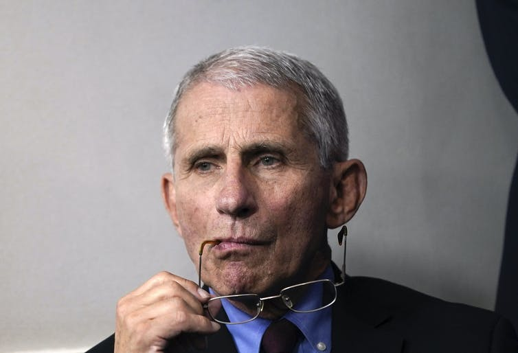 Dr. Anthony Fauci sits at the White House.