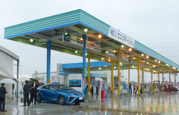 A hydrogen vehicle at a refuelling station
