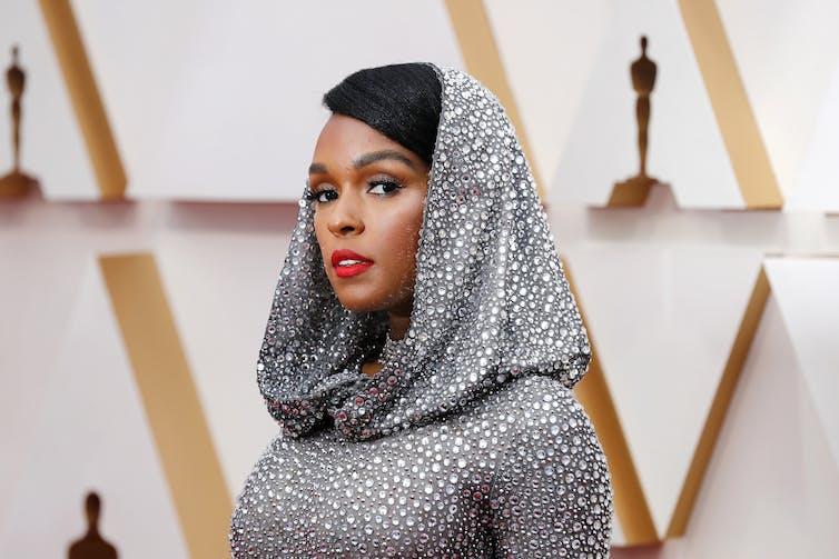 Glamorous woman in silver hood