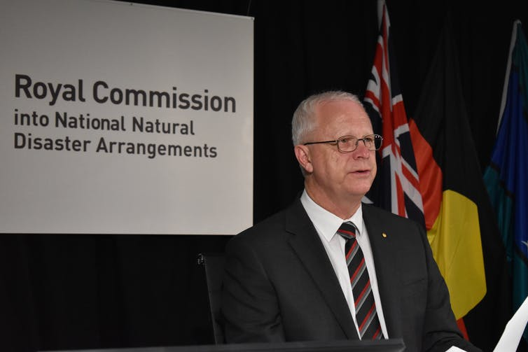 Mark Binskin in front of a sign that says 'Royal Commission into National Natural Disaster Arrangements'