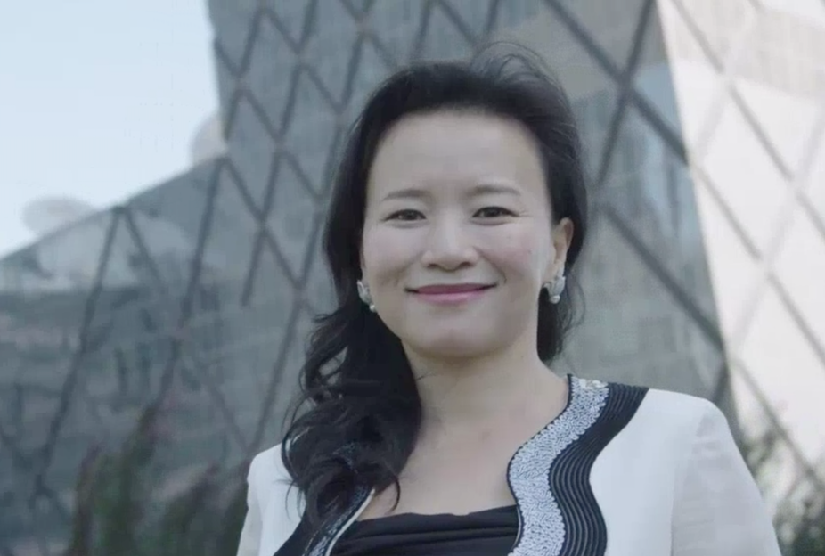 Detained CGTN achor Cheng Lei in front of a Beijing skyline.