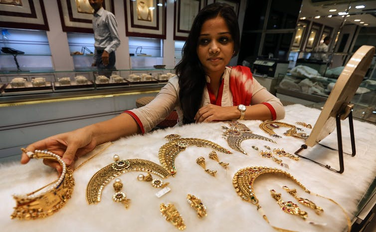 Woman shops for gold jewellery in Mumbai.
