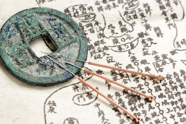 Acupuncture needles and ancient medicine illustration