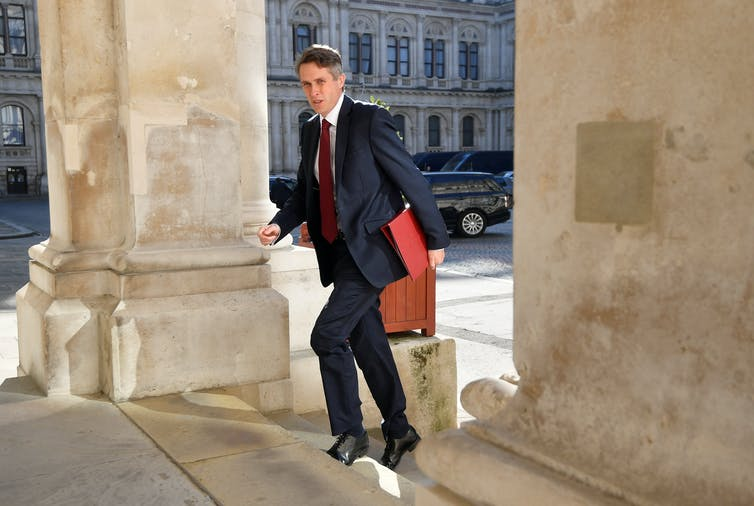 Education minister Gavin Williamson enter a government building.