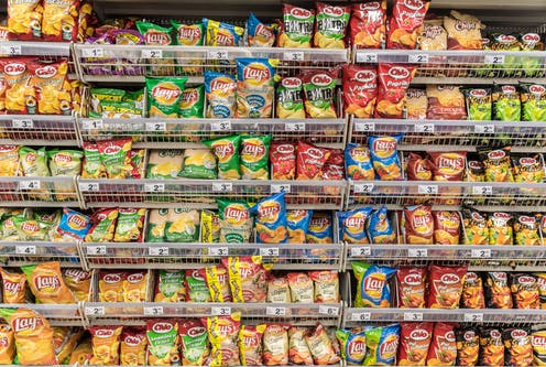 Chip packets in a supermarket aisle