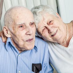 Portrait of elderly couple at home