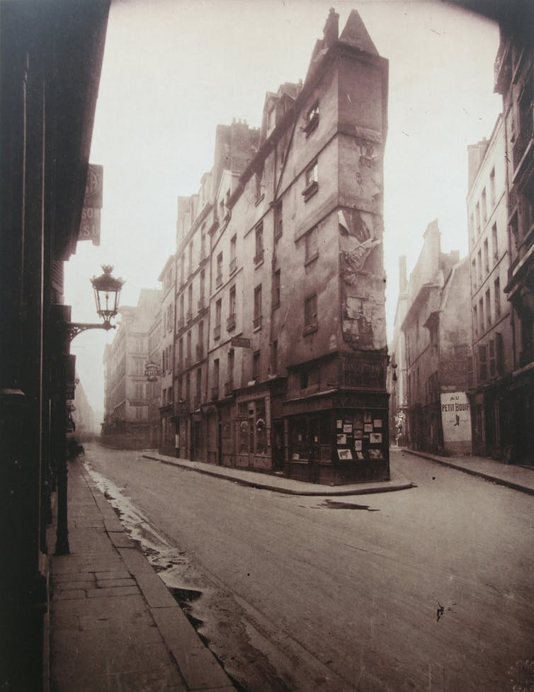 Brown-scale photo of an empty French street.